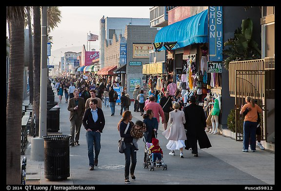 People stroll on Ocean Front Walk. Venice, Los Angeles, California, USA (color)