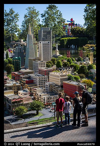 Familly looks at San Francisco built from legos, Legoland, Carlsbad. California, USA (color)
