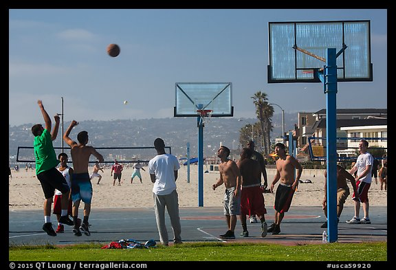 Men playing basketball, Mission Beach. San Diego, California, USA (color)
