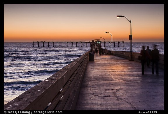 Walking on Ocean Beach Pier after sunset. San Diego, California, USA (color)