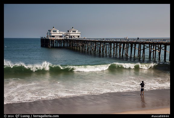 Man fishing next to Malibu Pier. Los Angeles, California, USA (color)