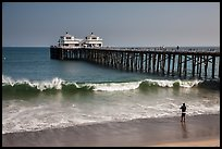 Man fishing next to Malibu Pier. Los Angeles, California, USA ( color)