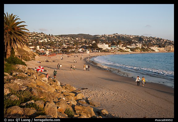 Beach with people strolling in late afternoon. Laguna Beach, Orange County, California, USA (color)