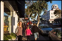 Visitors walk on sidewalk in shopping area. Laguna Beach, Orange County, California, USA ( color)