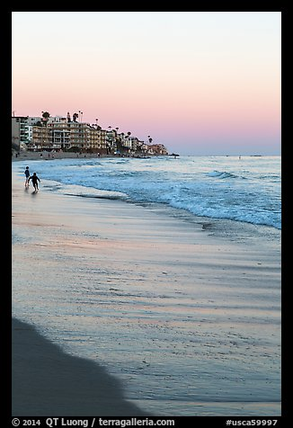 Beach at sunset with children playing. Laguna Beach, Orange County, California, USA (color)