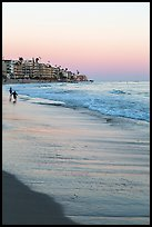 Beach at sunset with children playing. Laguna Beach, Orange County, California, USA ( color)