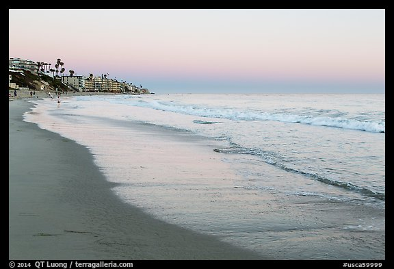 Beach at sunset with colors of sky reflected in wet sand. Laguna Beach, Orange County, California, USA (color)