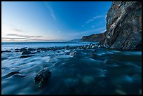 Creek, boulders, cliff, and ocean at dusk. Big Sur, California, USA ( color)