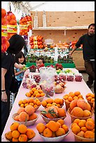 Customers buying fruit at stand. California, USA ( color)