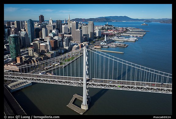 Aerial view of Bay Bridge, downtown, and piers. San Francisco, California, USA (color)