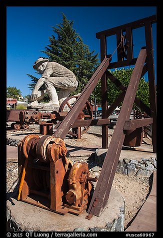 Mining equipment and statue commemorating gold rush, Auburn. California, USA (color)