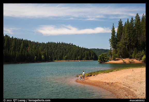 Family on shore of Jenkinson Lake, Pollock Pines. California, USA (color)