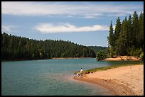 Family on shore of Jenkinson Lake, Pollock Pines. California, USA ( color)