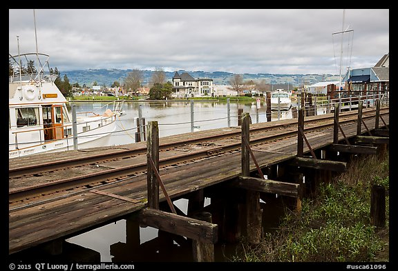 Railroad tresle and Petaluma River and Yacht Club. Petaluma, California, USA (color)