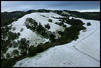 Aerial view of Evergreen Hills covered by hail. San Jose, California, USA ( color)
