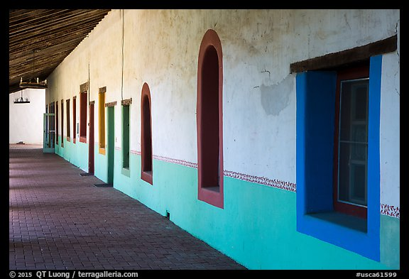 Brightly colored windows, inside arcade, Mission San Miguel. California, USA (color)