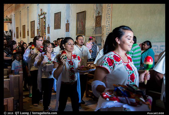 Mexican worshippers during festival, Mission San Miguel. California, USA (color)