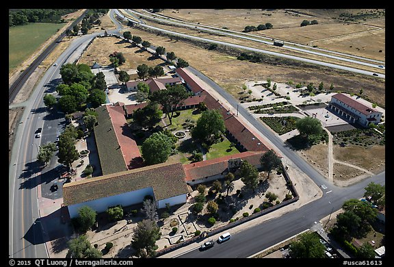 Aerial view of Mission San Miguel between railroad and highway. California, USA (color)