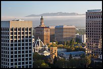 Downtown San Jose with early morning fog over hills. San Jose, California, USA ( color)