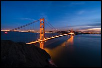 Golden Gate Bridge and city from Battery Spencer, dusk. San Francisco, California, USA ( color)