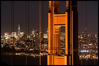Golden Gate Bridge pillar and San Francisco skyline at night. San Francisco, California, USA ( color)