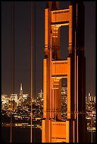 Golden Gate Bridge pillar and city skyline at night. San Francisco, California, USA ( color)