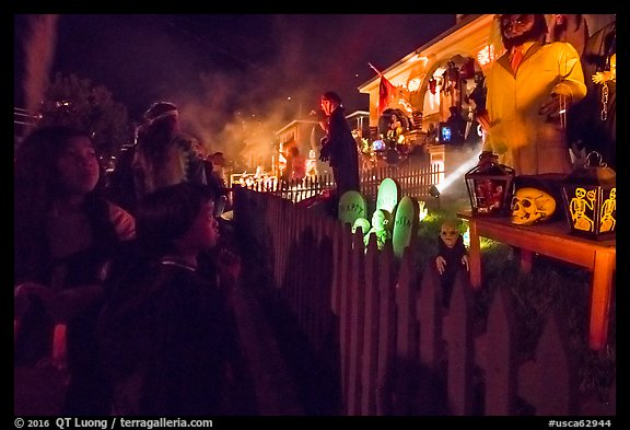 Children look at house with Halloween decorations. Petaluma, California, USA (color)