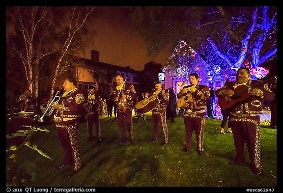 Mariachi musicians in front of decorated house. Petaluma, California, USA (color)