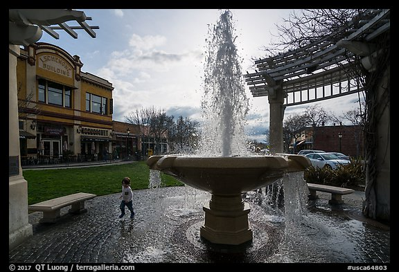 Fountain and plaza with child playing. Livermore, California, USA (color)