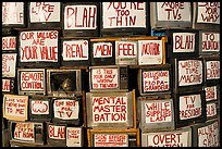 Wall of televisions covered with slogans, Slab City. Nyland, California, USA ( color)