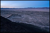 Lava field and mountains from Amboy Crater at dusk. Mojave Trails National Monument, California, USA ( color)