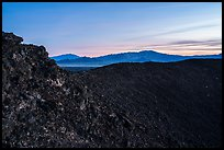 Rim of Amboy Crater and mountains at dusk. Mojave Trails National Monument, California, USA ( color)