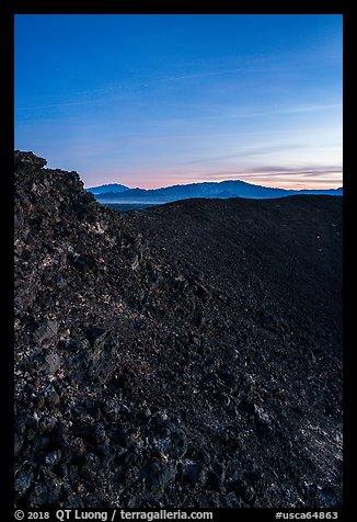 Interior slopes of Amboy Crater and mountains at dusk. Mojave Trails National Monument, California, USA (color)
