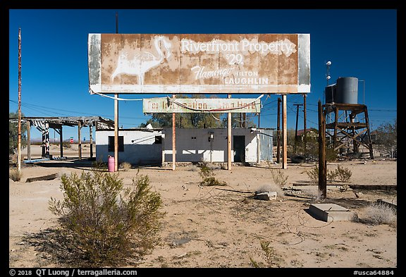 Old billboard and abandonned gas station. Mojave Trails National Monument, California, USA (color)