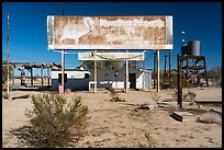 Old billboard and abandonned gas station. Mojave Trails National Monument, California, USA ( color)