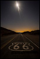Route 66 marking and moon at night. Mojave Trails National Monument, California, USA ( color)