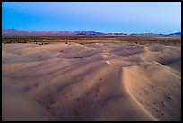 Aerial view of sand dunes and mountains at dusk, Cadiz Dunes. Mojave Trails National Monument, California, USA ( color)