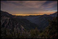 Mountains and distant Los Angeles Basin at night. San Gabriel Mountains National Monument, California, USA ( color)
