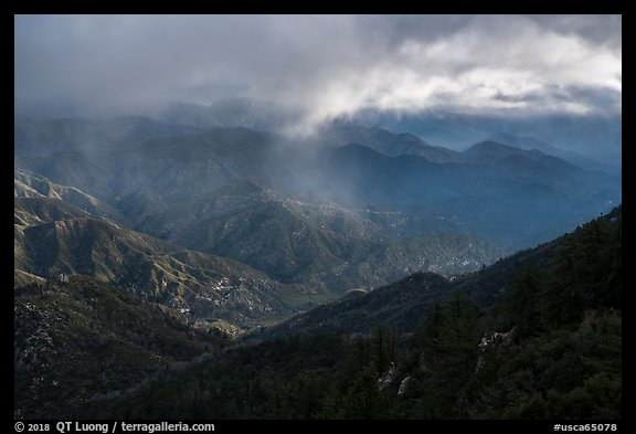 Rolling peaks under storm sky with shaft of light. San Gabriel Mountains National Monument, California, USA (color)