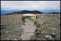 Snow Mountain West Summit marker with Tibetan prayer flags. Berryessa Snow Mountain National Monument, California, USA ( color)