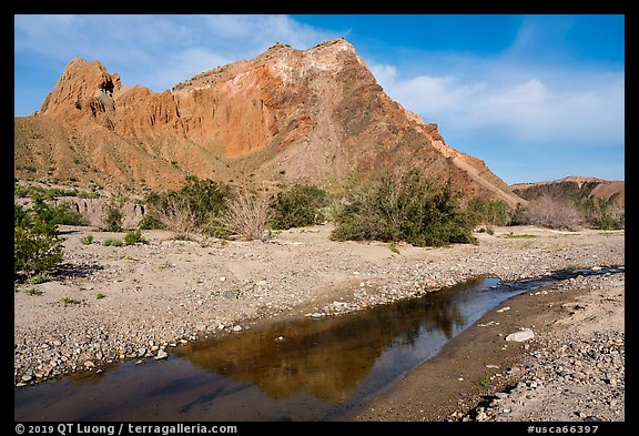 Colorful cliffs rise above the Mojave River in Afton Canyon. Mojave Trails National Monument, California, USA (color)