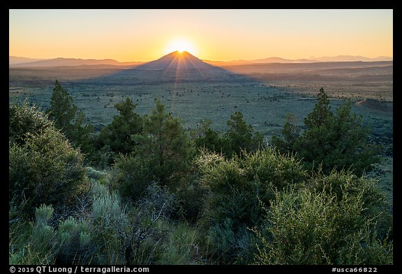 Whitney Butte with sun setting. Lava Beds National Monument, California, USA (color)