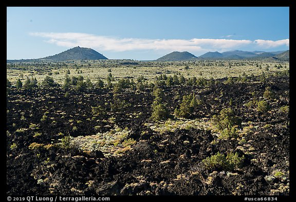 Homestead Flow and volcanic buttes. Lava Beds National Monument, California, USA (color)