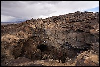 Depression and entrance to lava tube cave. Mojave Trails National Monument, California, USA ( color)