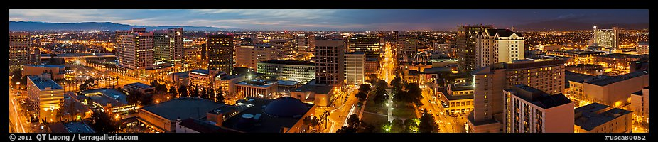 Downtown San Jose skyline and Cesar de Chavez Park at dusk. San Jose, California, USA (color)