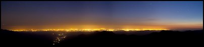 Central Valley lights at dusk seen from Morro Rock. California, USA (Panoramic color)