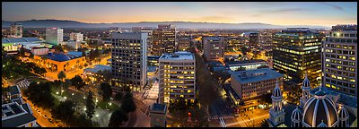 Downtown San Jose skyline and Santa Cruz Mountains at dusk. San Jose, California, USA