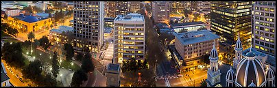 Downtown San Jose buildings after sunset. San Jose, California, USA (Panoramic color)