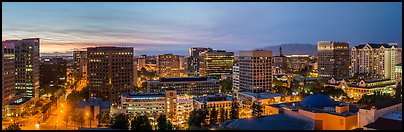 San Jose skyline at dusk from Adobe building to Fairmont hotel. San Jose, California, USA (Panoramic color)