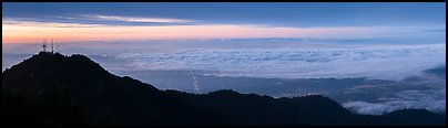 Los Angeles Basin covered with sea of clouds from Mount Wilson, sunrise. San Gabriel Mountains National Monument, California, USA (Panoramic color)